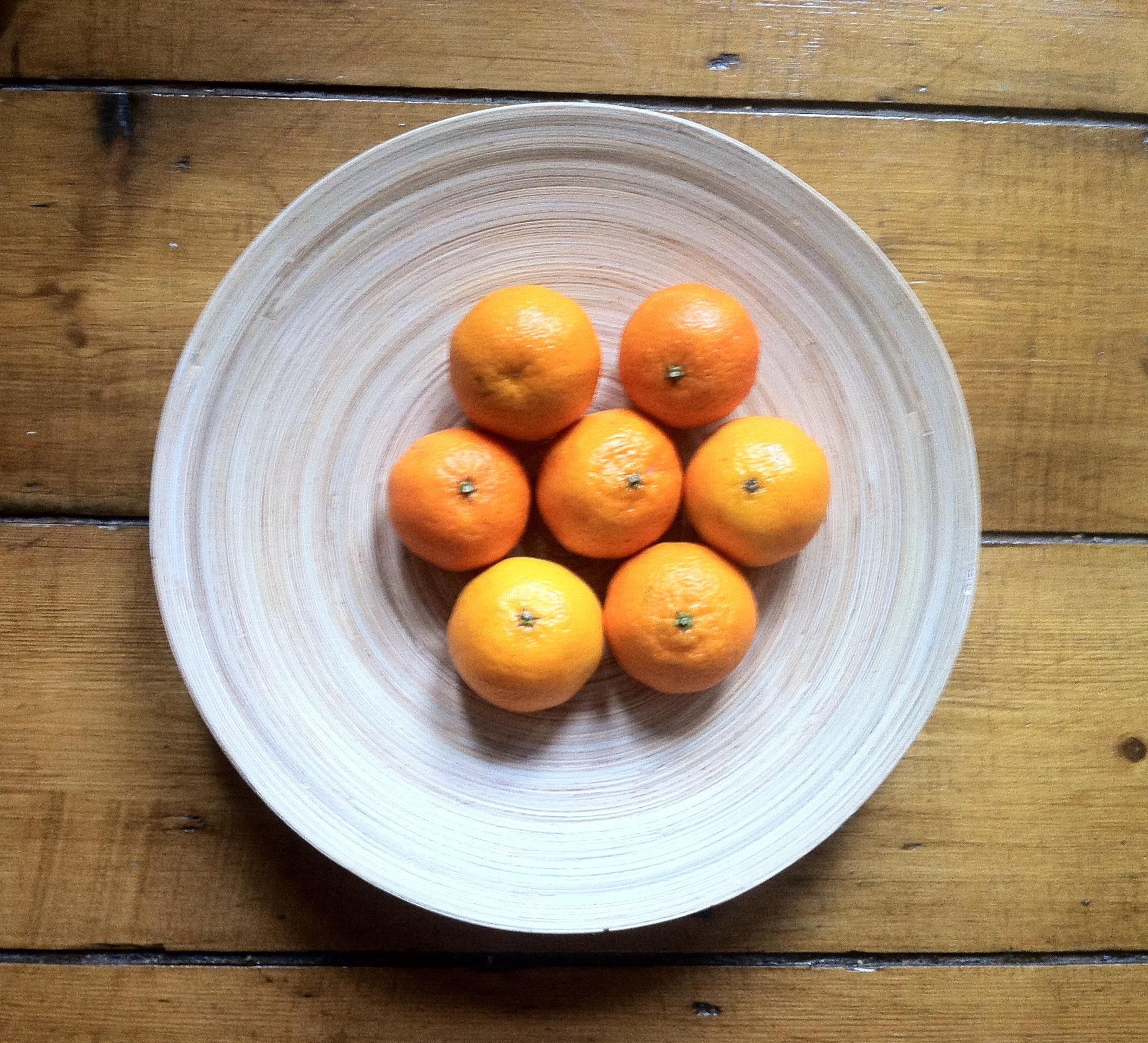 Satsumas in bowl