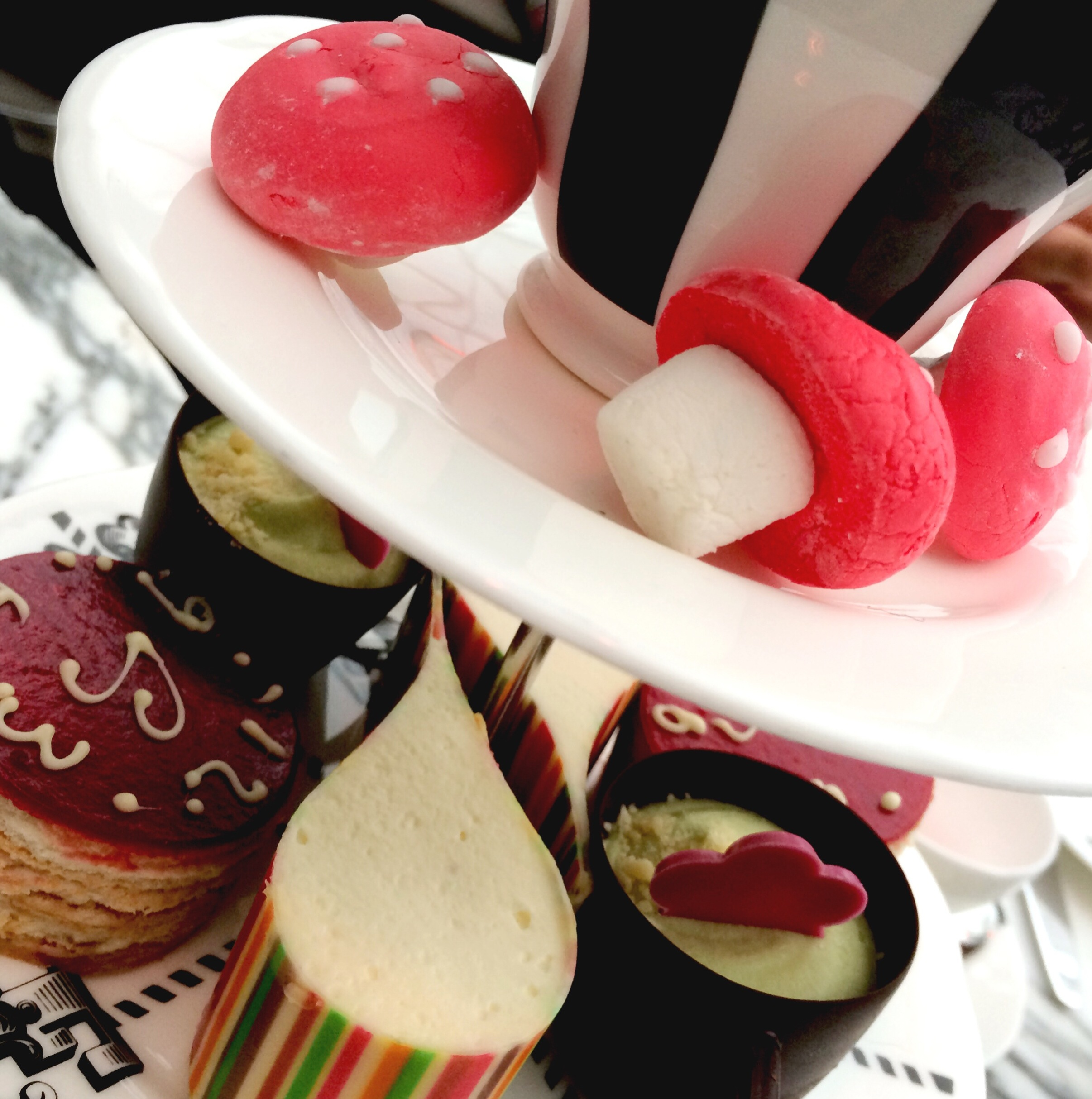 Tea and cakes at The Sanderson in London - afternoon tea with a twist! Find out more at www.ababyonboard.com