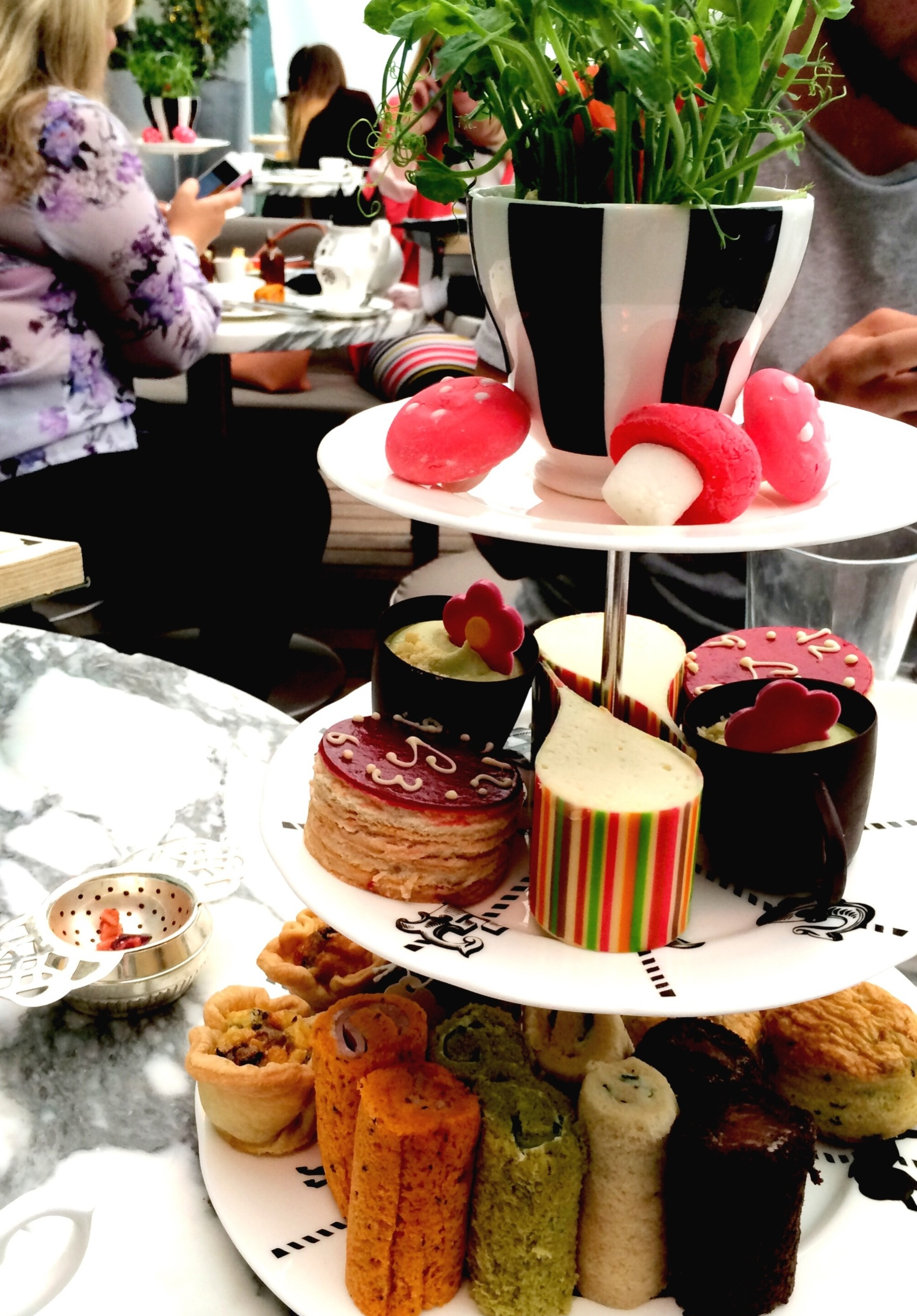 Afternoon tea at The Sanderson Hotel in London - traditional afternoon tea but with a twist - it's themed on the Mad Hatter's Tea Party with an Alice in Wonderland twist. Is it the best place to have afternoon tea in London? Find out more at www.ababyonboard.com