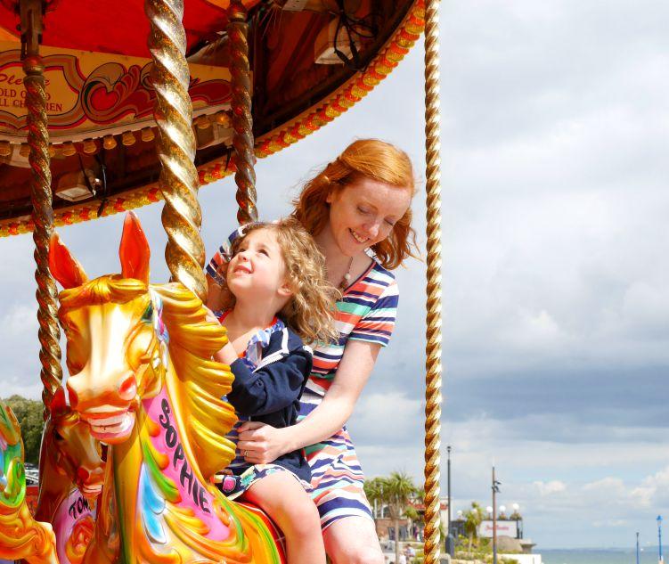 Riding a fairground carousel horse