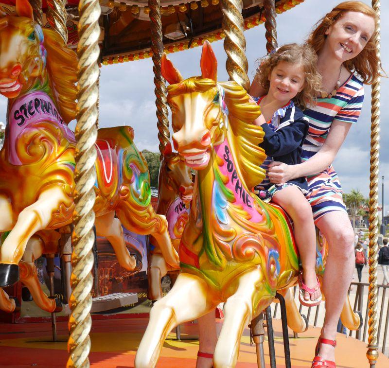 Holiday carousel horse fairground ride