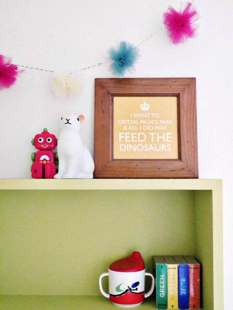 Pom pom garland and children's colourful bookshelf