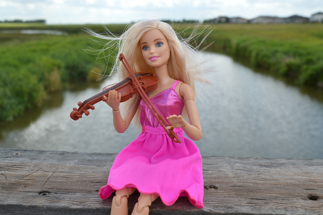 Barbie playing the world's smallest violin
