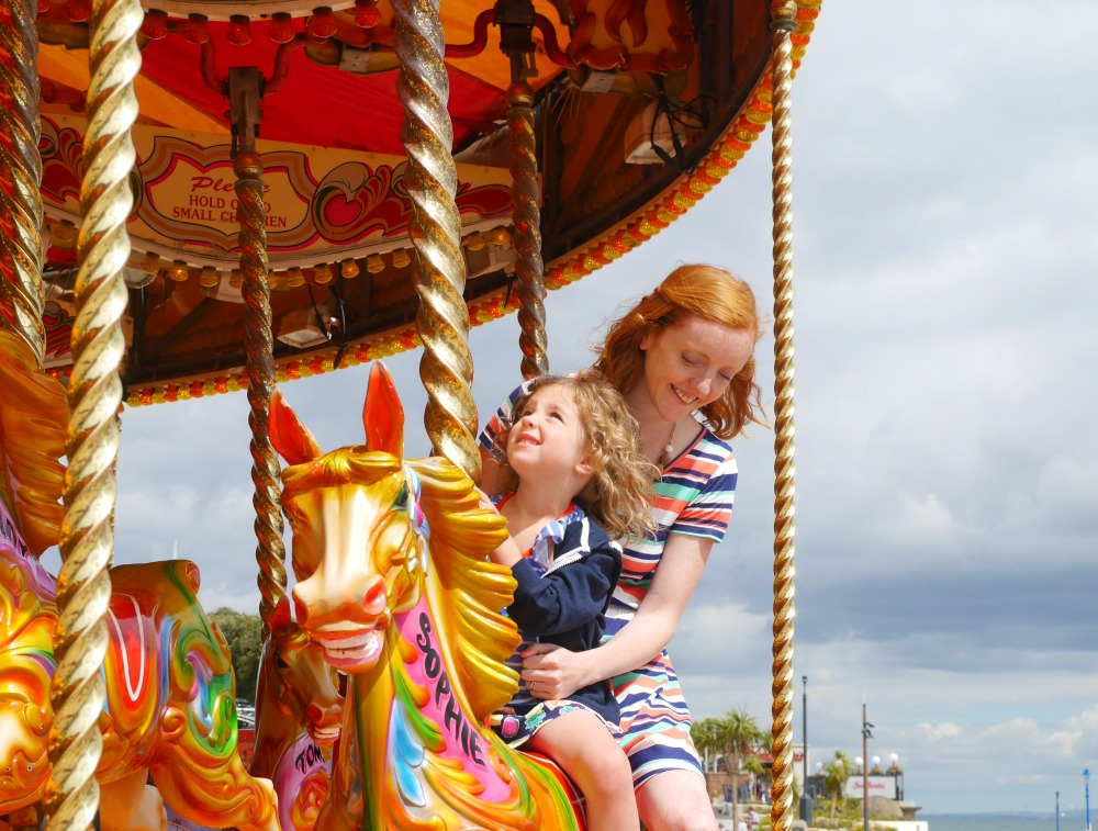 Carousel ride on holiday - tips for stress-free train travel with small children