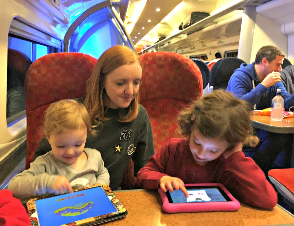 Tips for stress-free travel by train with small children - take iPads
