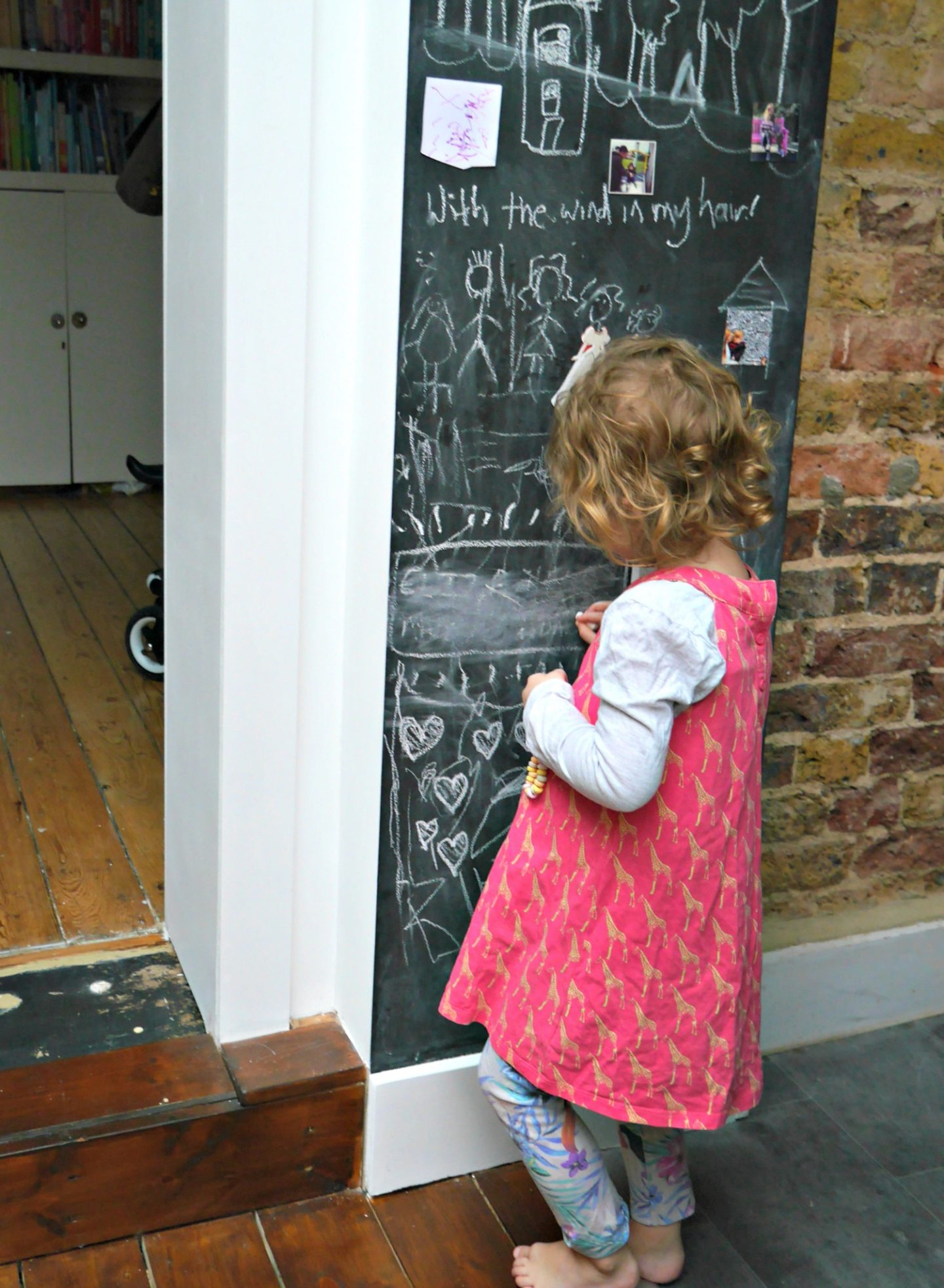 Magnetic chalkboard walls in kitchens, with exposed brick