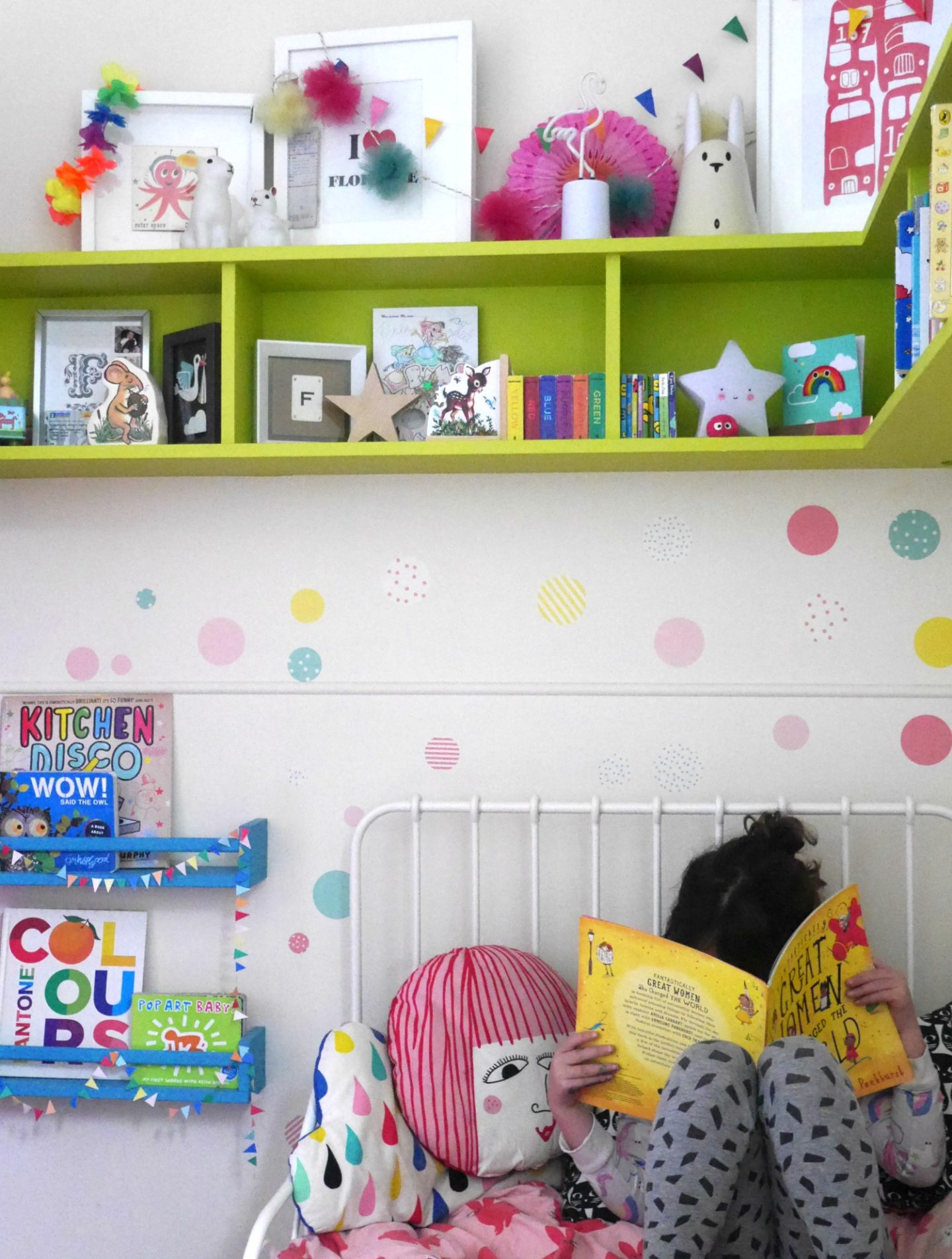 Colourful children's bedrooms with painted book shelves and wall stickers