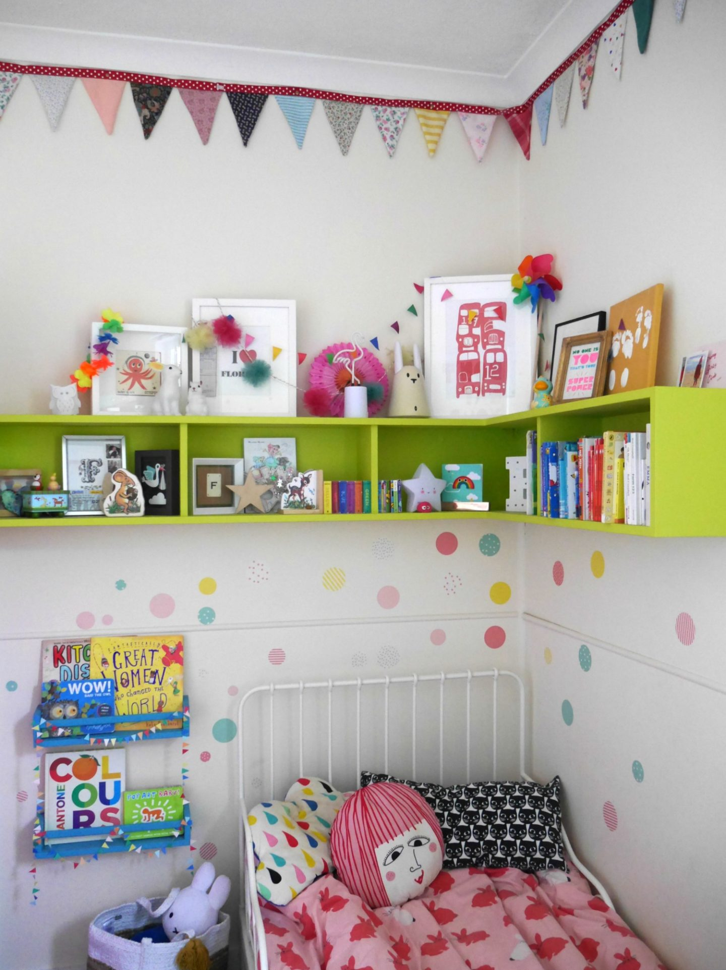 Colourful children's bedrooms with painted shelves and wall stickers