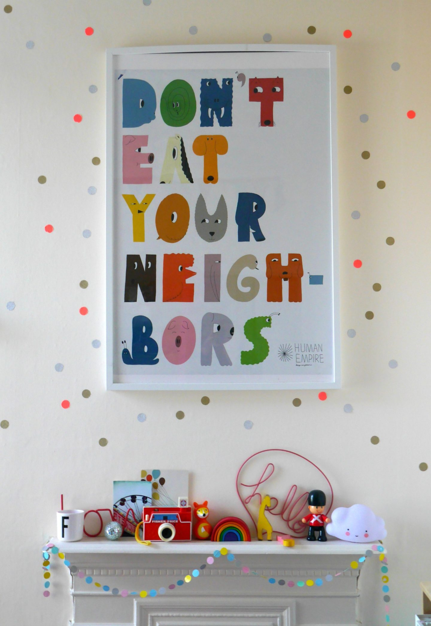 Don't eat youre neighbours poster and DIY wall stickers in a colourful children's bedroom
