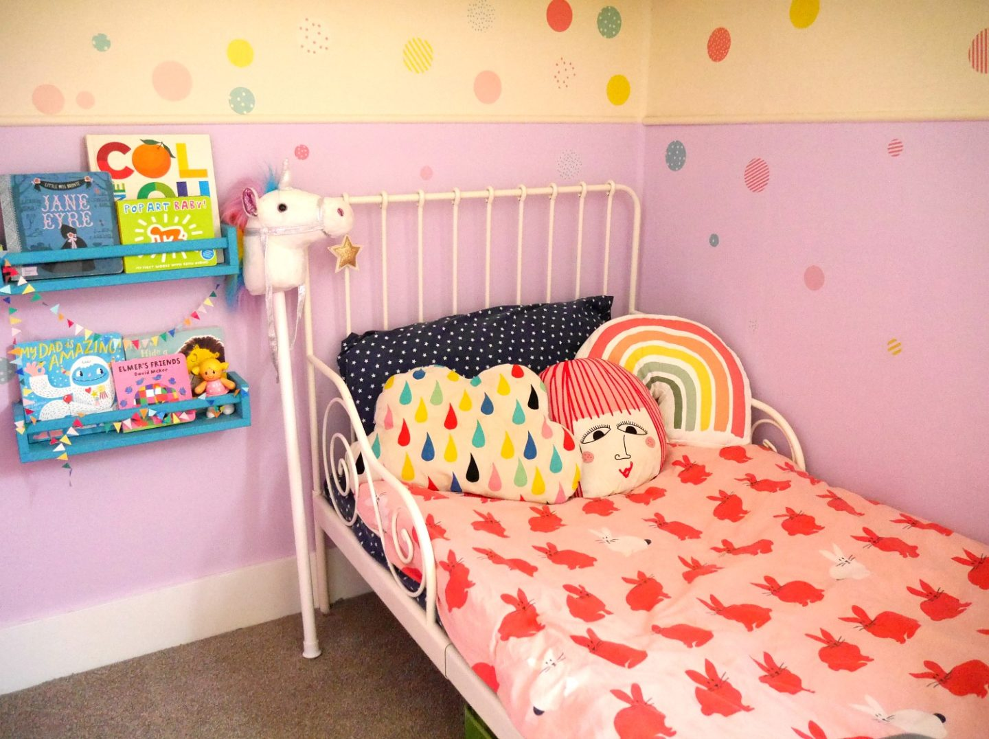Colourful children's rooms - how to add colour to your family home. Painted purple wall with lavender cupcake